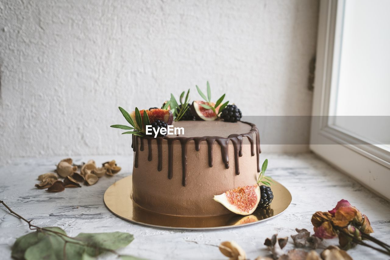 indoors, freshness, food and drink, food, table, sweet food, still life, no people, leaf, sweet, indulgence, dessert, celebration, temptation, plant part, cake, holiday, wall - building feature, home interior