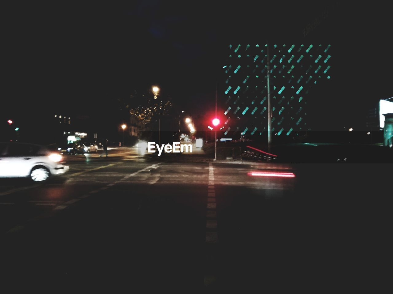 illuminated, night, transportation, car, motor vehicle, city, mode of transportation, street, land vehicle, architecture, road, building exterior, built structure, street light, no people, direction, motion, lighting equipment, the way forward, nature, outdoors, dark, nightlife