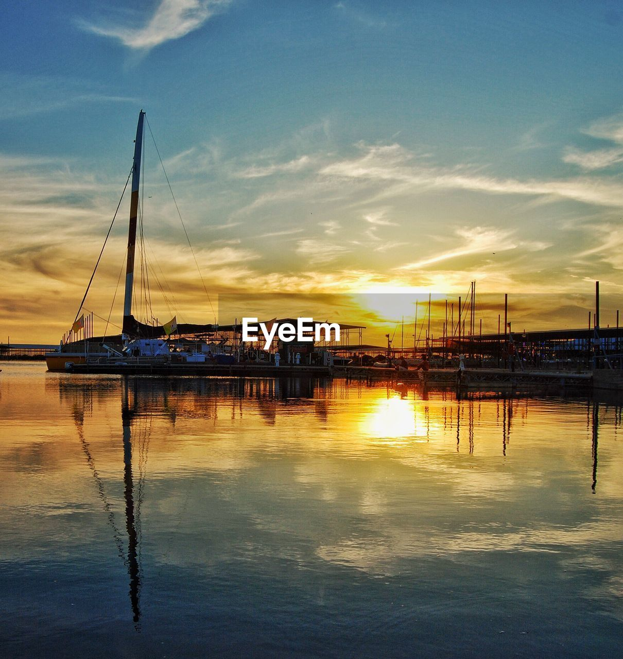 reflection, water, sunset, sky, cloud - sky, beauty in nature, scenics, built structure, tranquil scene, tranquility, nature, outdoors, waterfront, architecture, no people, nautical vessel, sea, transportation, sailboat, mast, day