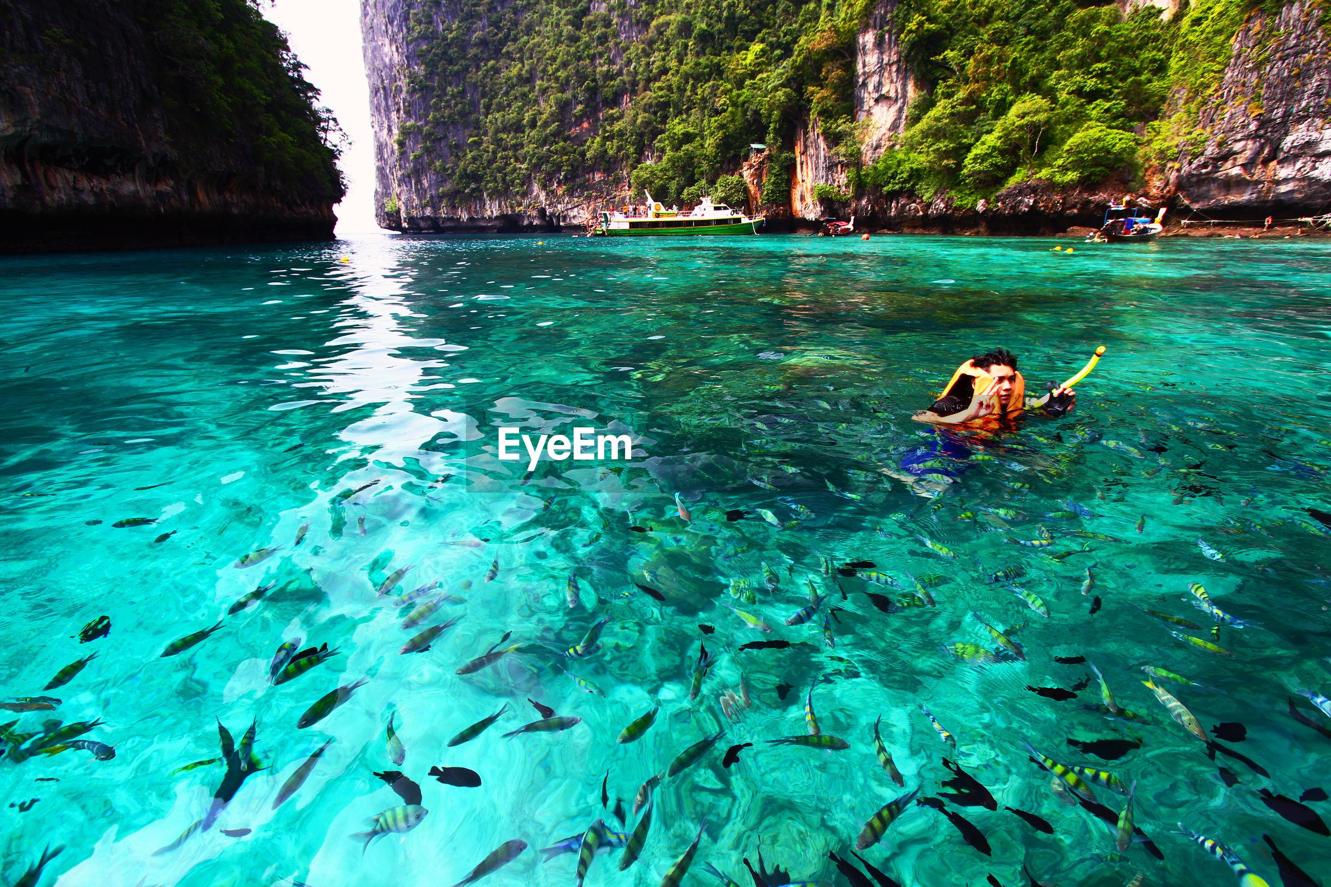REAR VIEW OF PERSON IN SEA