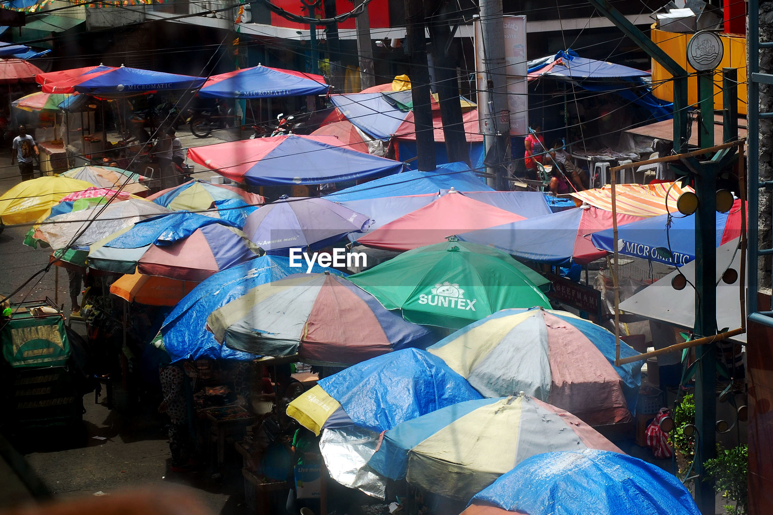 High angle view of parasols at street market