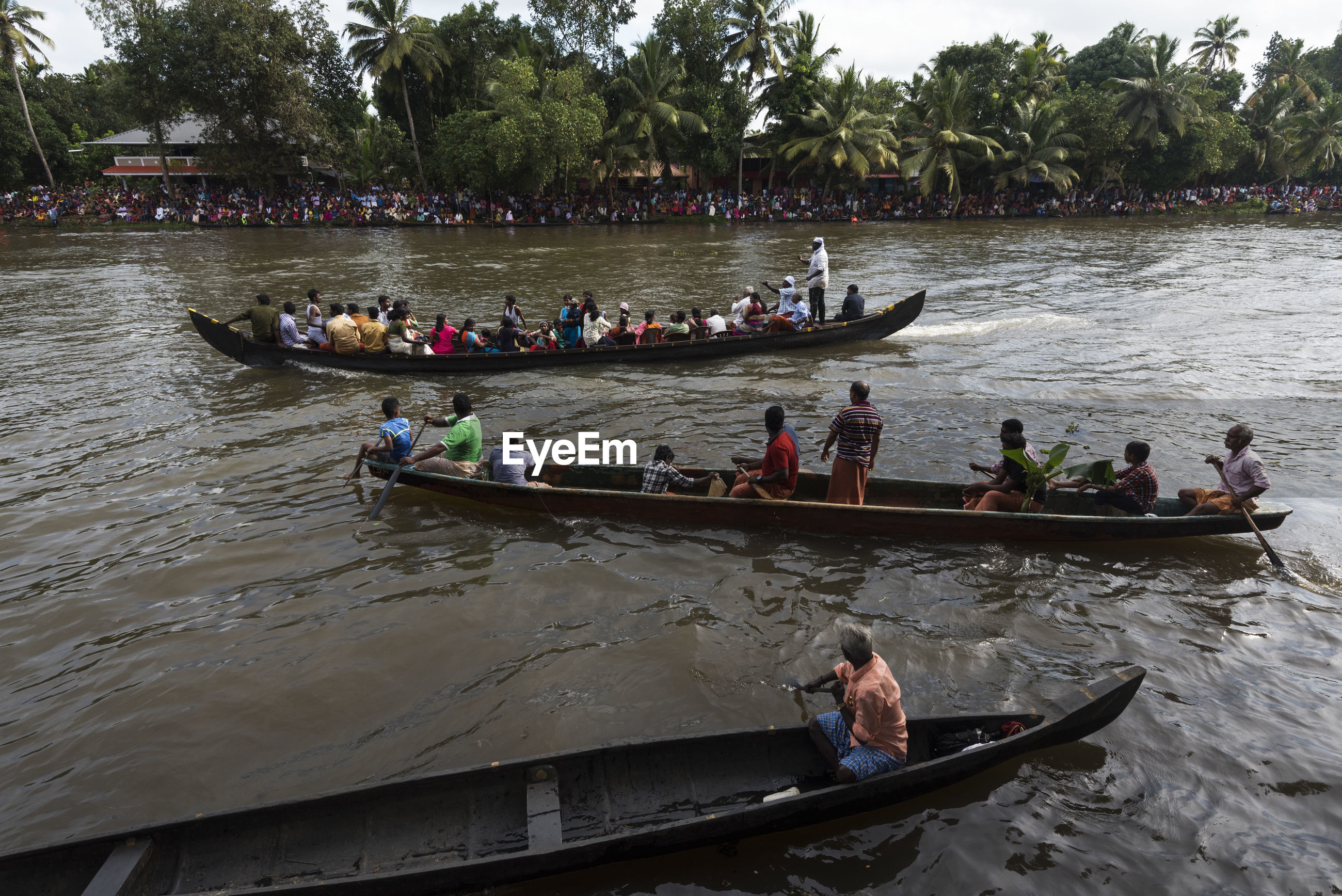 PEOPLE IN BOAT SAILING ON RIVER