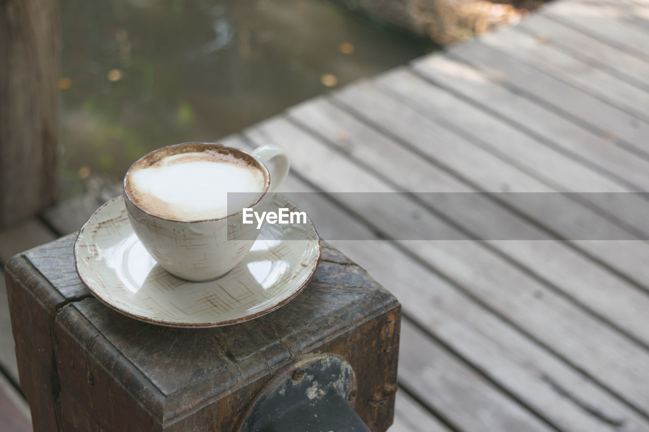 High Angle View Of Coffee On Wood Fence Post