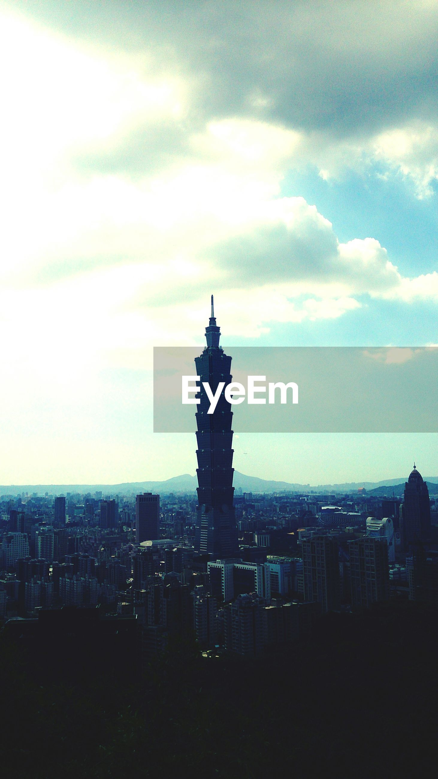 Taipei 101 and cityscape against sky