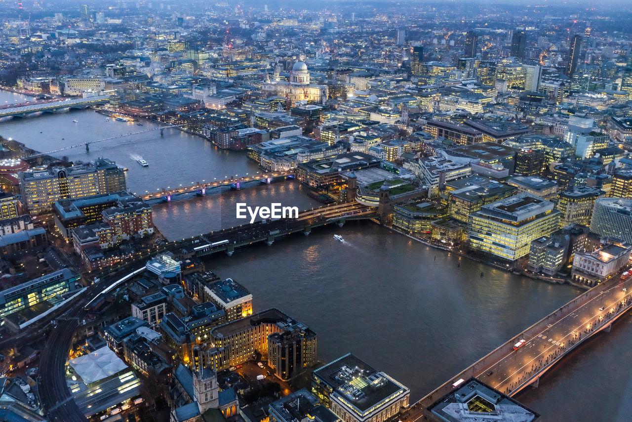 Aerial Of Bridges Over River In Illuminated City