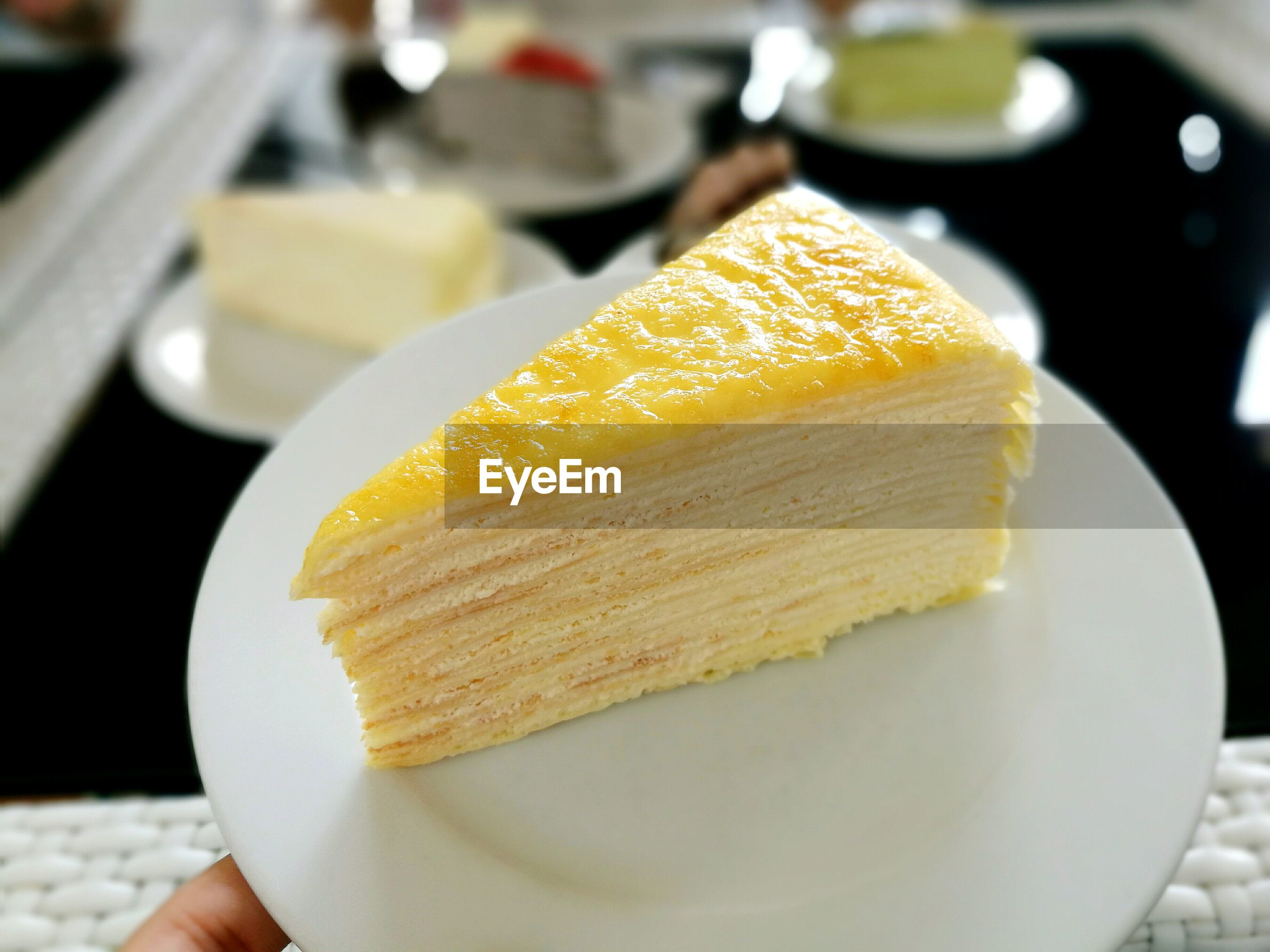 High angle view of mille crepe in plate at restaurant