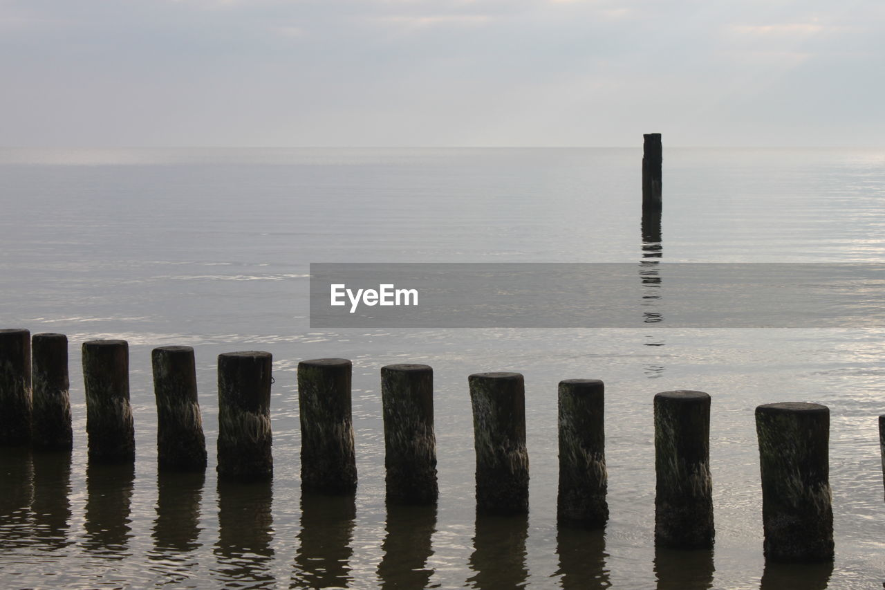 water, sea, wooden post, beauty in nature, no people, horizon over water, tranquility, nature, scenics, outdoors, tranquil scene, day, sky