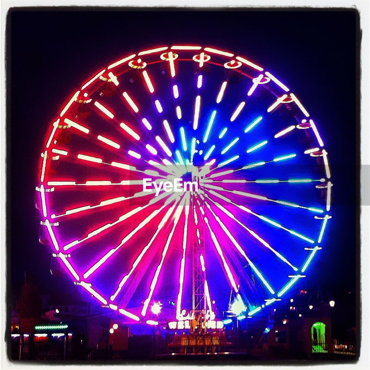 night, arts culture and entertainment, illuminated, amusement park, low angle view, ferris wheel, no people, outdoors, multi colored, amusement park ride, sky