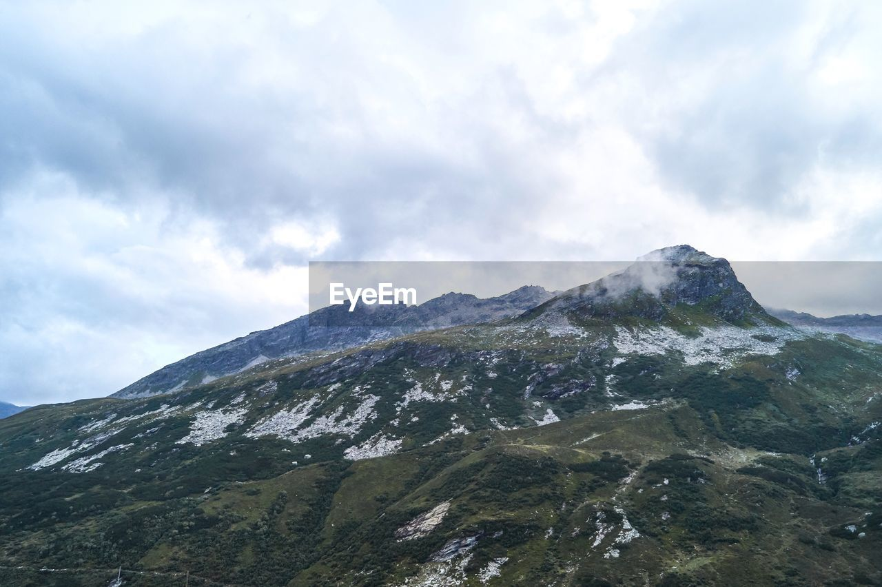 mountain, sky, cloud - sky, beauty in nature, scenics - nature, mountain range, environment, nature, tranquil scene, tranquility, landscape, no people, day, snow, non-urban scene, outdoors, cold temperature, mountain peak, idyllic