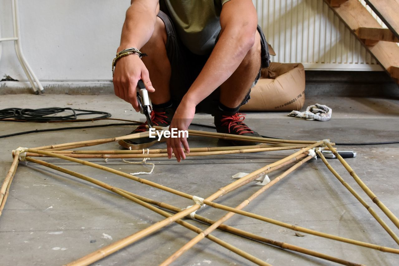Low Section Of Man Fixing A Frame