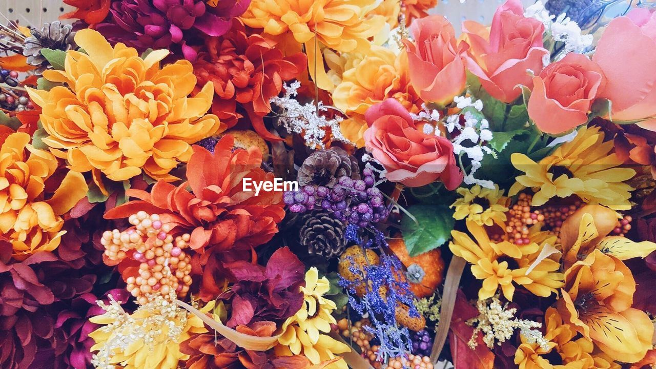 flower, petal, fragility, variation, flower market, beauty in nature, retail, freshness, flower shop, bouquet, for sale, multi colored, choice, flower head, nature, high angle view, no people, backgrounds, full frame, outdoors, day, close-up, florist