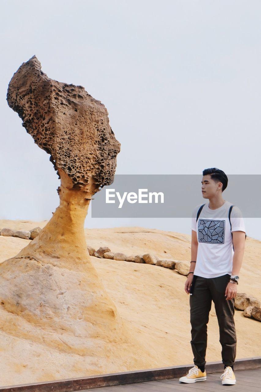 Full length of man standing at desert