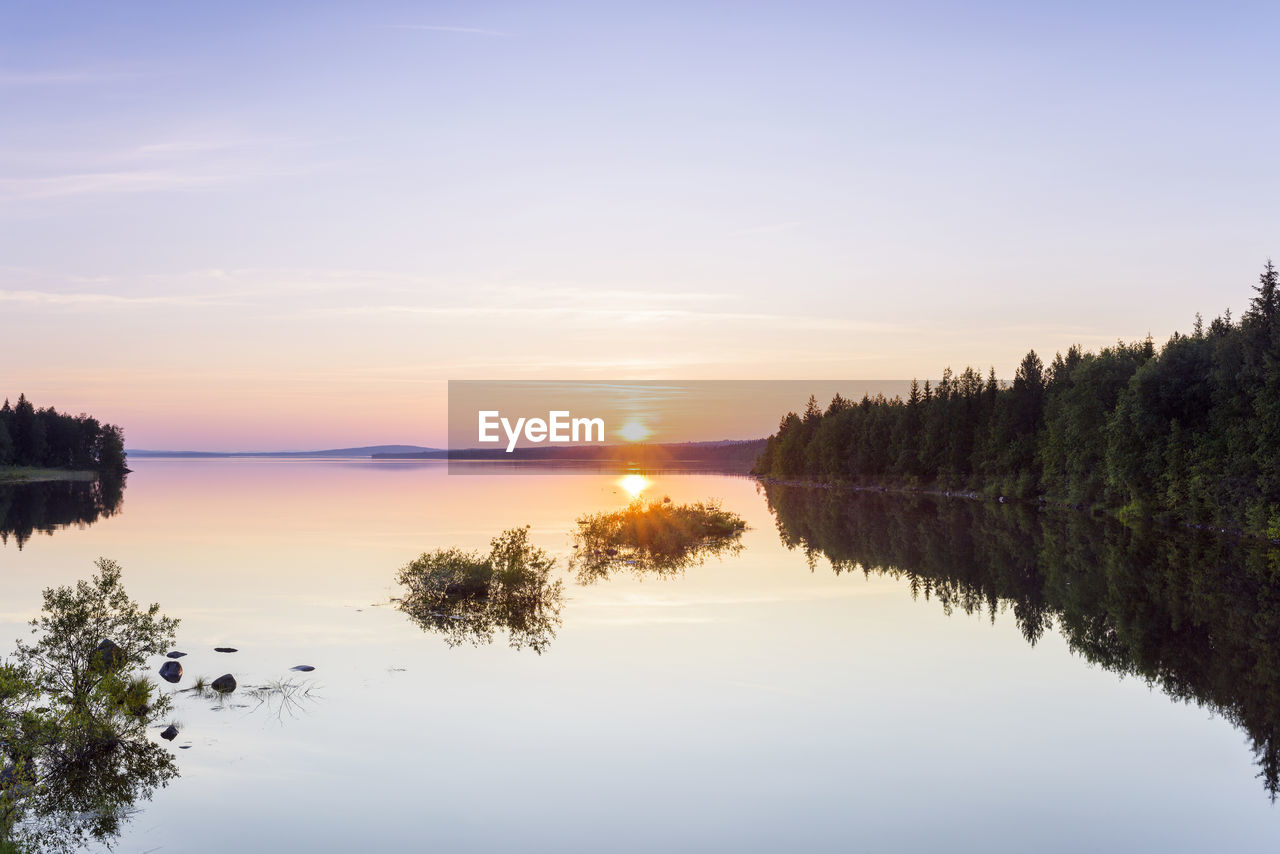 sky, water, scenics - nature, reflection, beauty in nature, sunset, tranquility, tranquil scene, lake, tree, non-urban scene, plant, idyllic, nature, no people, waterfront, sun, cloud - sky, sunlight, outdoors, reflection lake