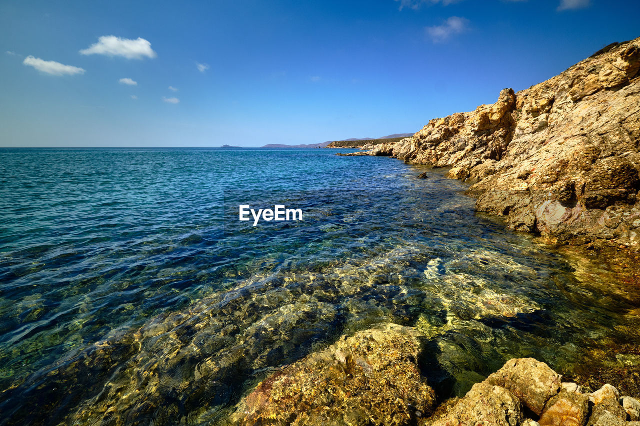 sea, water, sky, beauty in nature, scenics - nature, tranquility, tranquil scene, rock, blue, nature, idyllic, no people, rock - object, solid, day, horizon, horizon over water, land, waterfront, outdoors, turquoise colored, rocky coastline, shallow