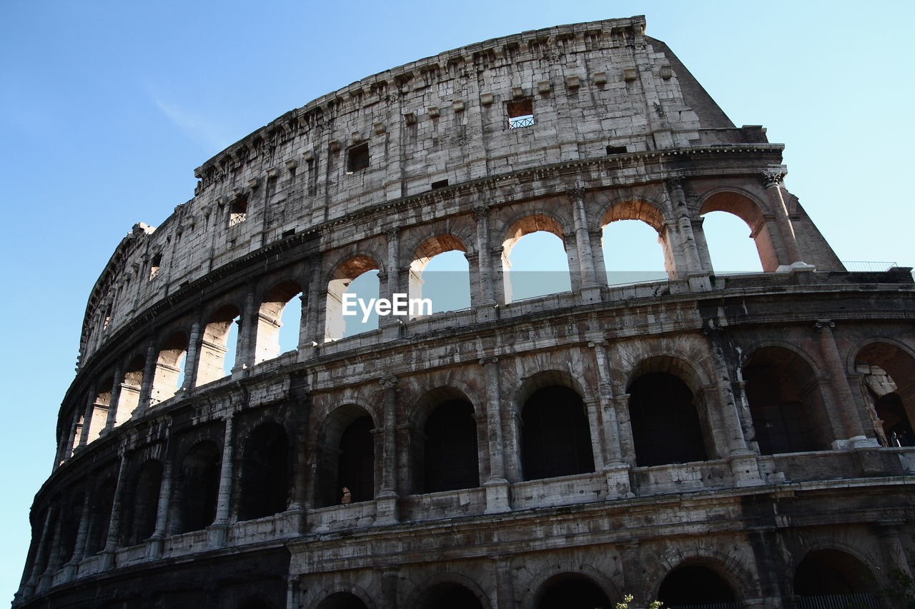 history, the past, architecture, arch, ancient, amphitheater, sky, built structure, low angle view, old ruin, building exterior, tourism, travel destinations, nature, travel, no people, ancient civilization, arts culture and entertainment, day, archaeology, ancient history, ruined, arched