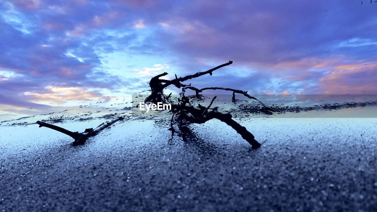 sky, cloud - sky, weather, nature, cold temperature, winter, silhouette, real people, outdoors, snow, frozen, full length, leisure activity, men, beauty in nature, water, scenics, sunset, day, one person, ice skate, people