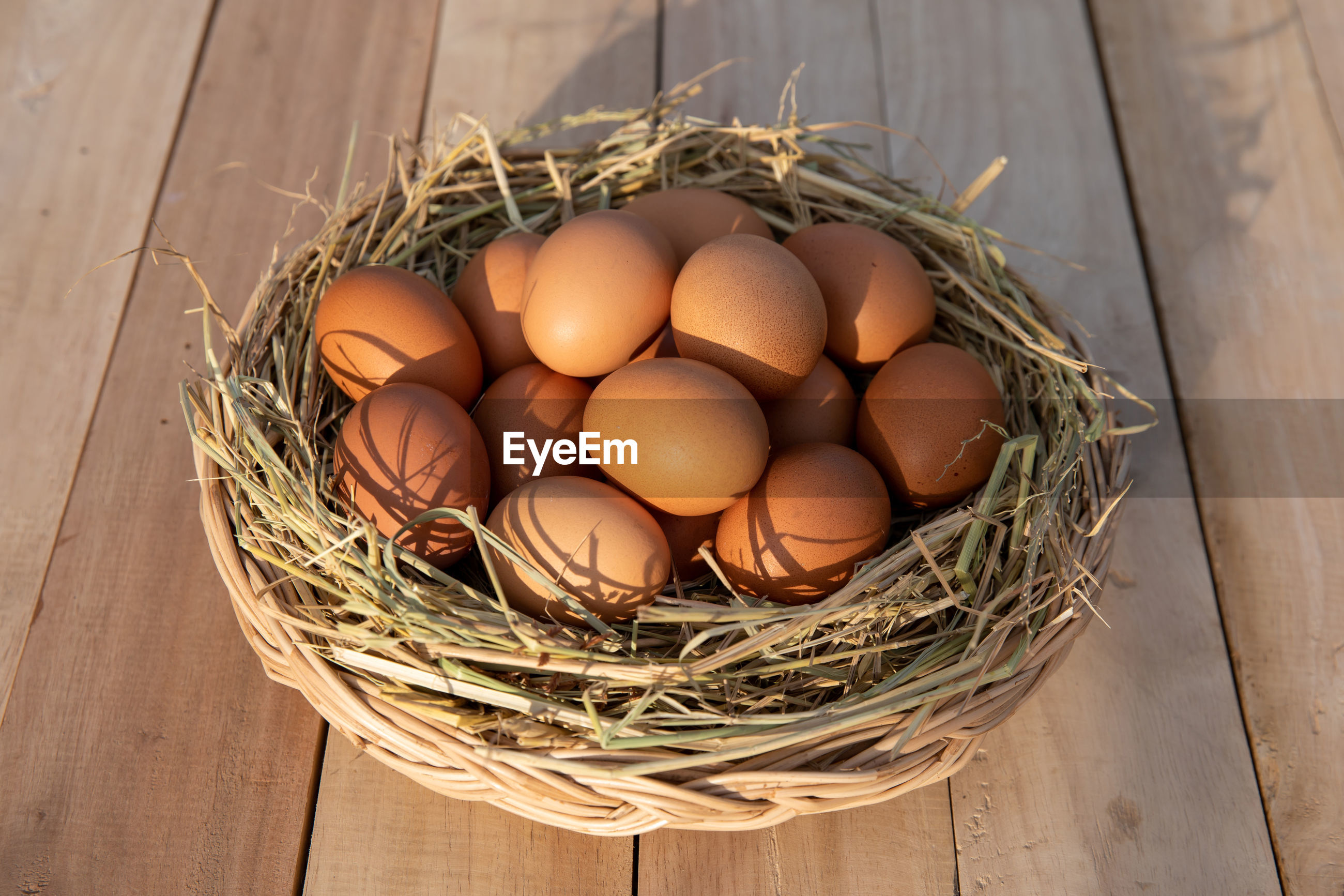 HIGH ANGLE VIEW OF EGGS IN WICKER BASKET