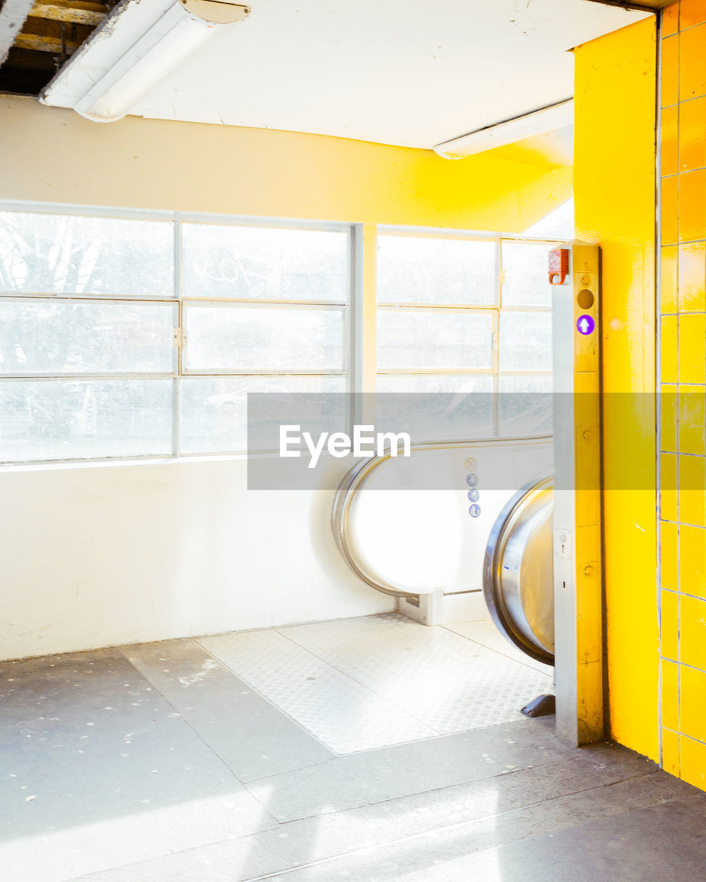 indoors, yellow, no people, flooring, door, sunlight, absence, day, architecture, window, entrance, tile, bathroom, domestic room, tiled floor, wall - building feature, built structure, hygiene, building, clean