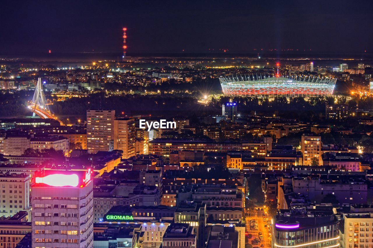 High Angle View Of Illuminated City Buildings At Night