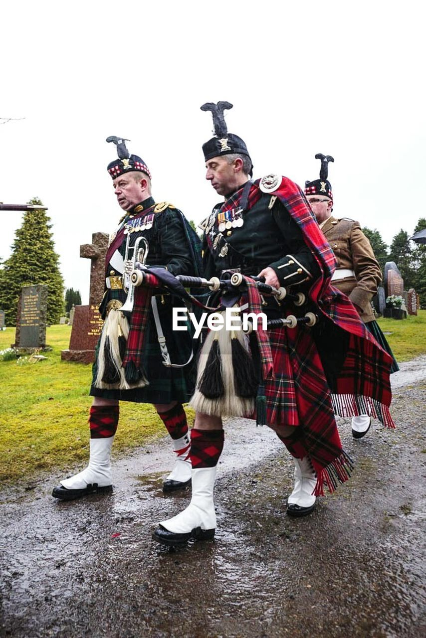 kilt, full length, uniform, real people, two people, men, day, togetherness, outdoors, young adult, only men, adult, people, adults only