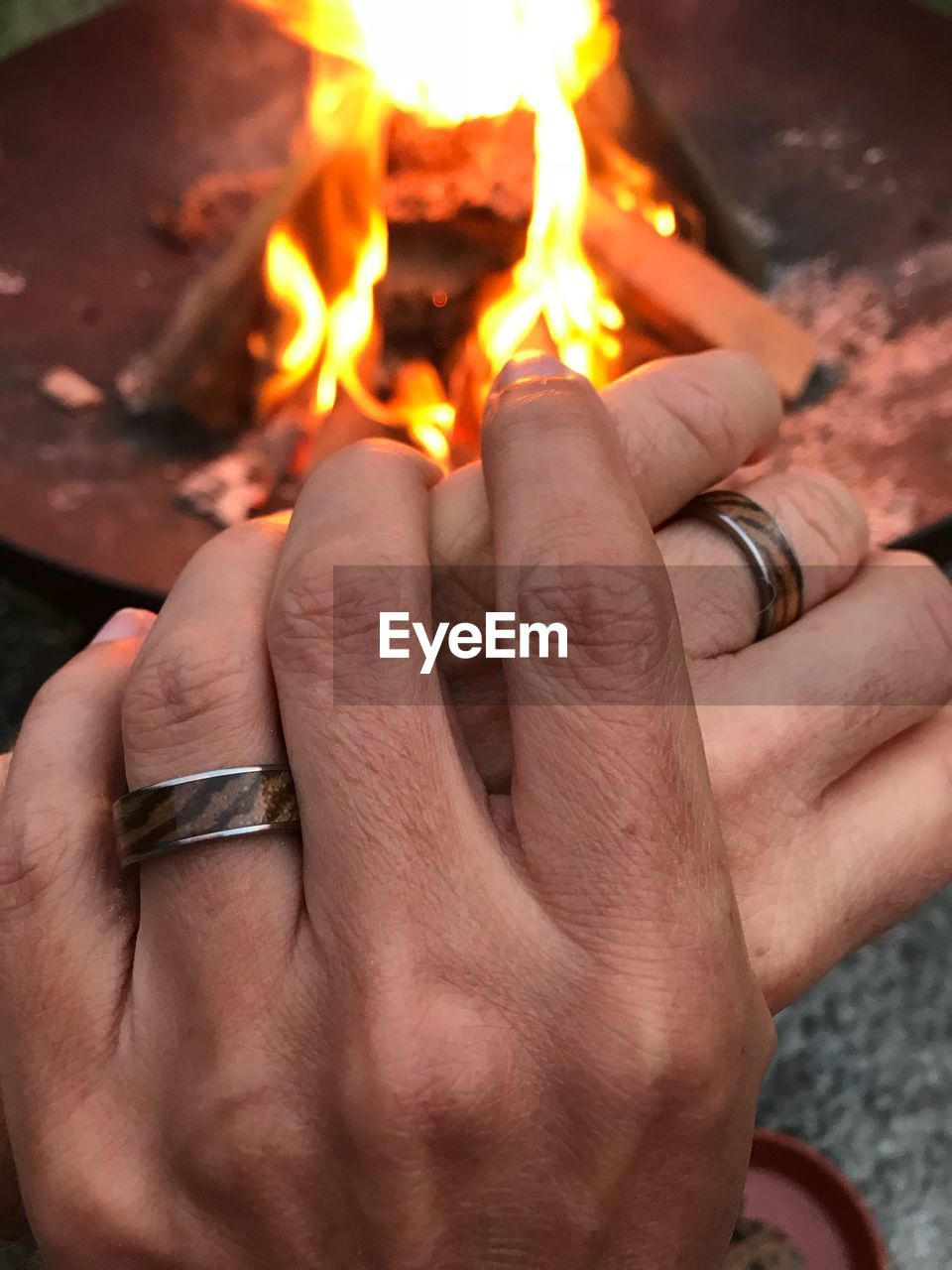 human hand, hand, burning, fire, fire - natural phenomenon, human body part, heat - temperature, real people, flame, people, body part, finger, human finger, glowing, men, holding, close-up, personal perspective, wood - material, bonfire