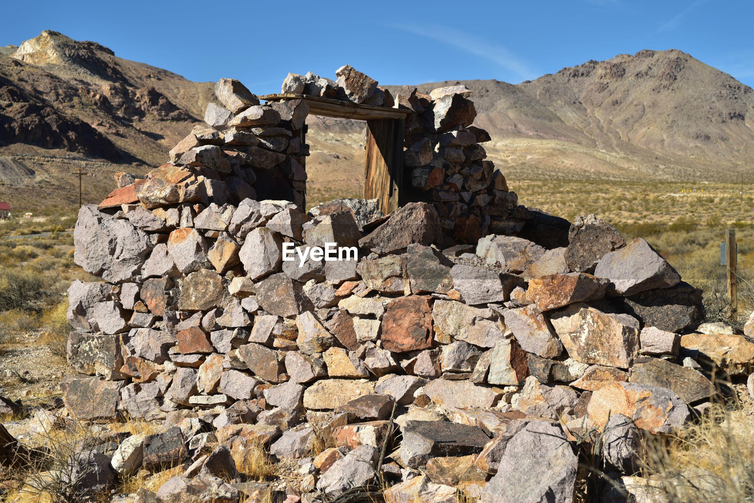 STONE WALL AGAINST MOUNTAIN RANGE