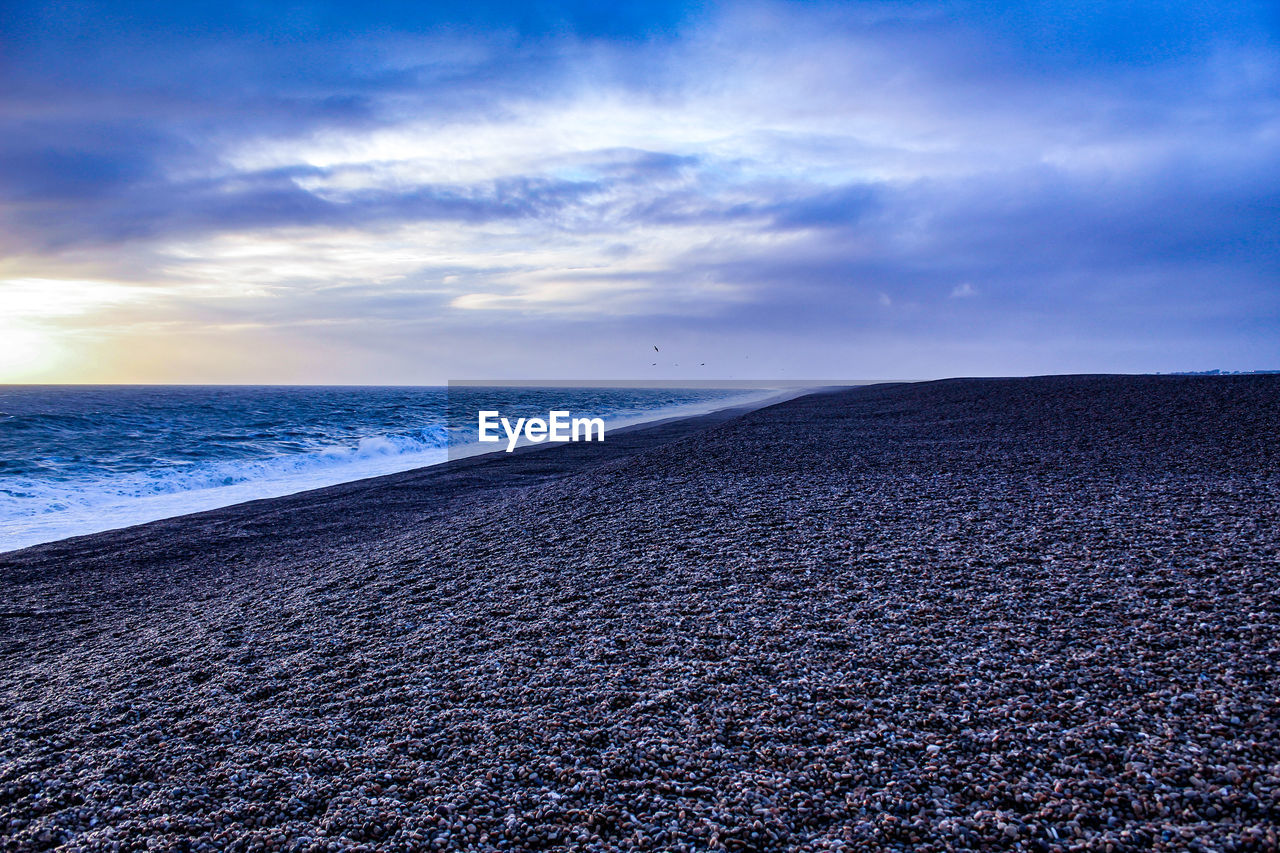 sky, cloud - sky, tranquil scene, water, scenics - nature, land, sea, tranquility, beach, beauty in nature, horizon, nature, horizon over water, no people, idyllic, non-urban scene, outdoors, day, pebble