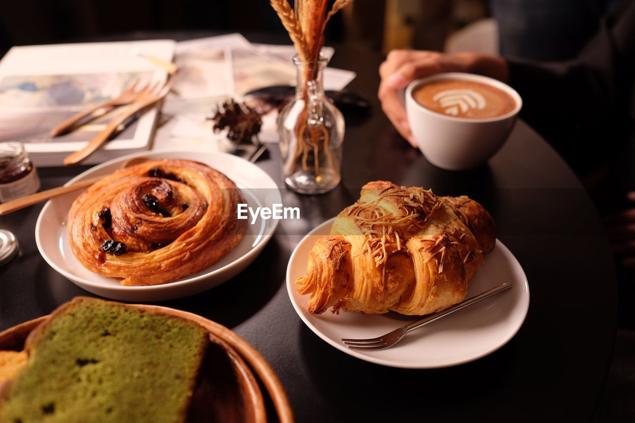 food and drink, drink, freshness, table, refreshment, plate, food, ready-to-eat, indoors, coffee, coffee - drink, still life, cup, coffee cup, no people, mug, close-up, serving size, focus on foreground, baked, glass, temptation, crockery, french food