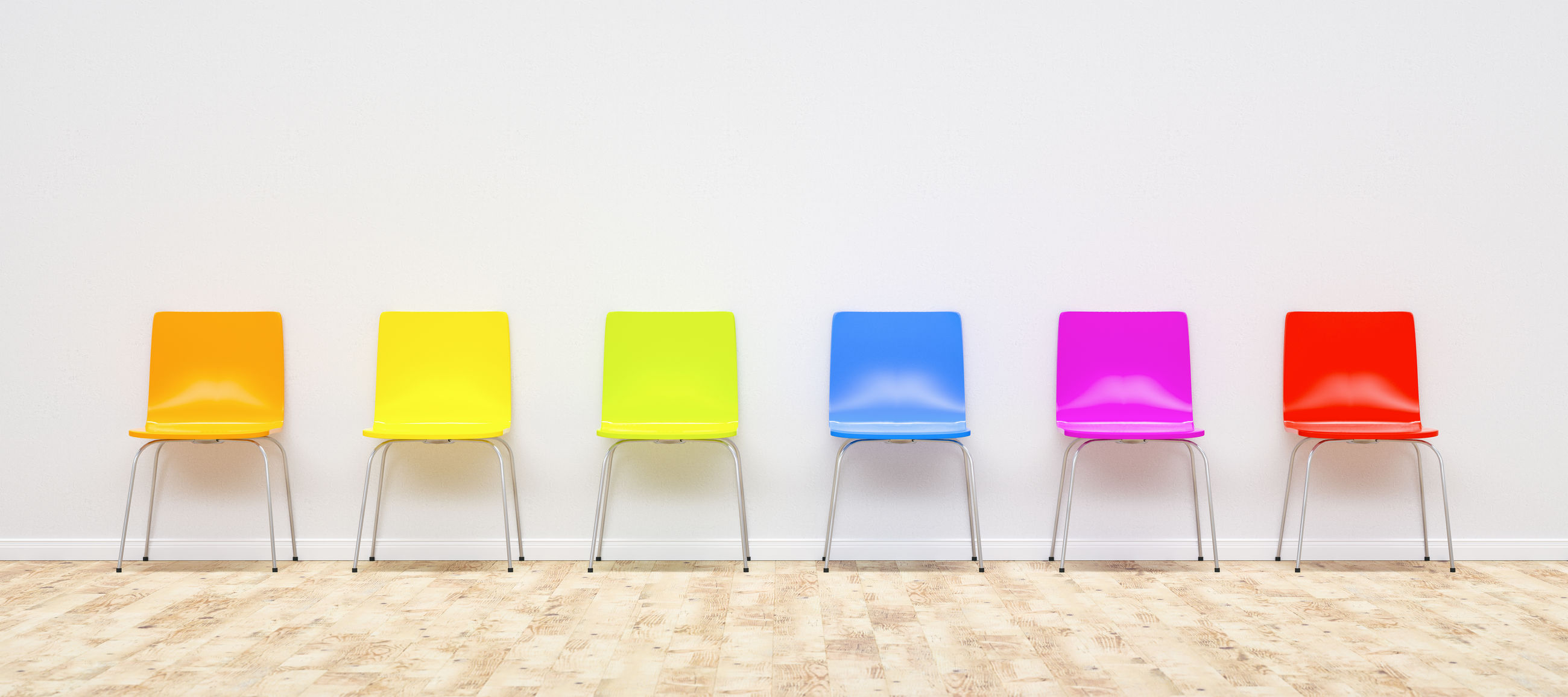 Colorful chairs against wall