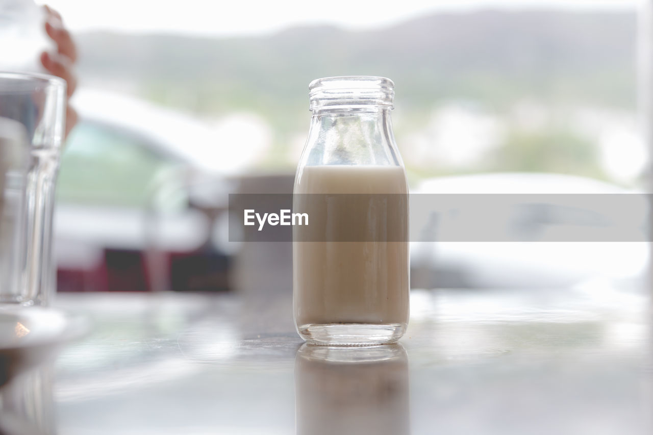 Close-up of milk in bottle on table