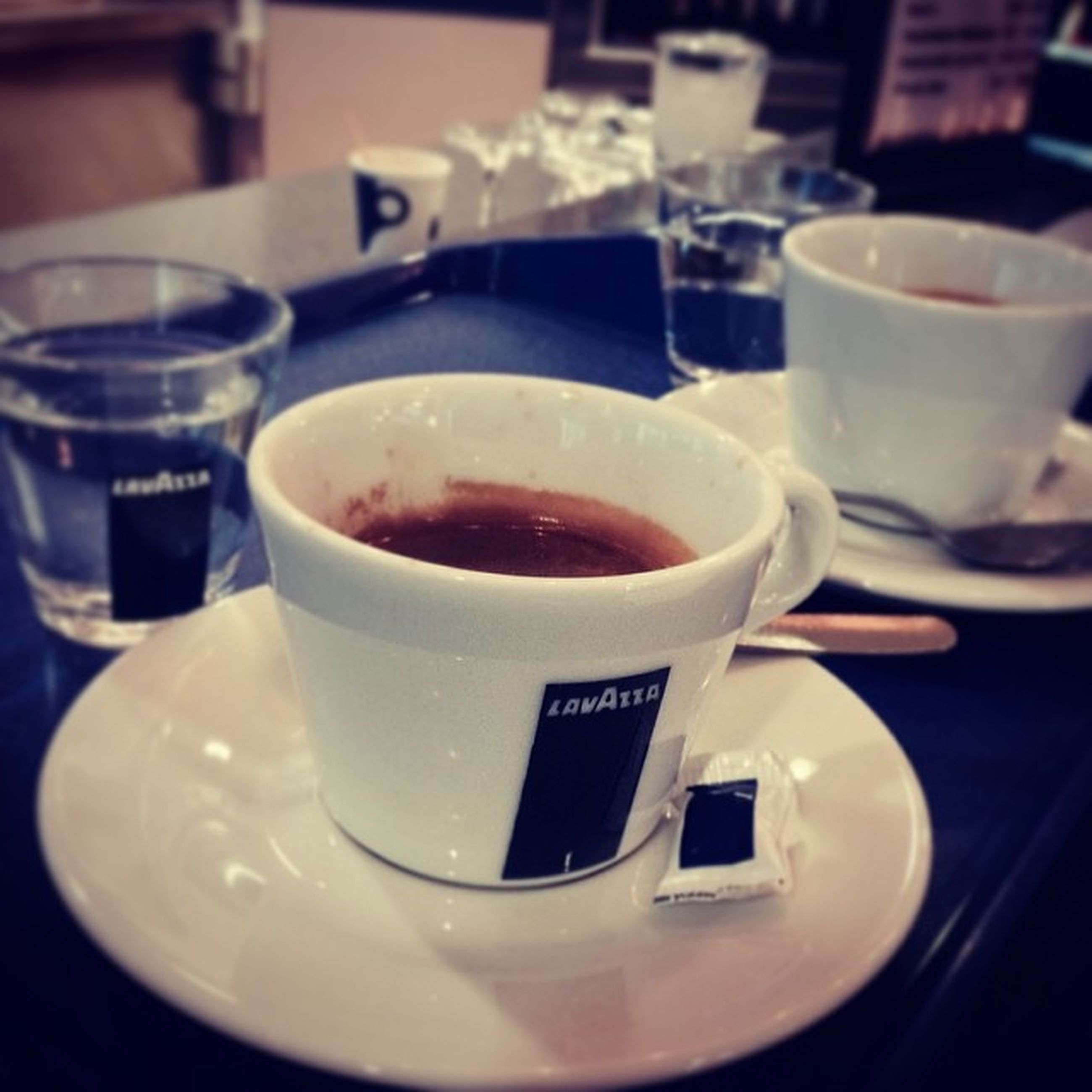 food and drink, drink, indoors, coffee cup, table, freshness, refreshment, saucer, coffee - drink, still life, coffee, cup, close-up, frothy drink, spoon, plate, tea cup, breakfast, food, no people