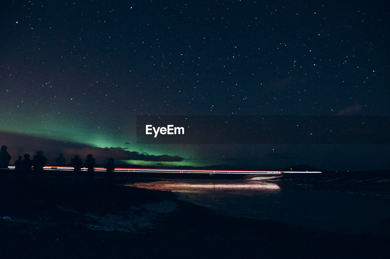 VIEW OF LAKE AGAINST SKY AT NIGHT