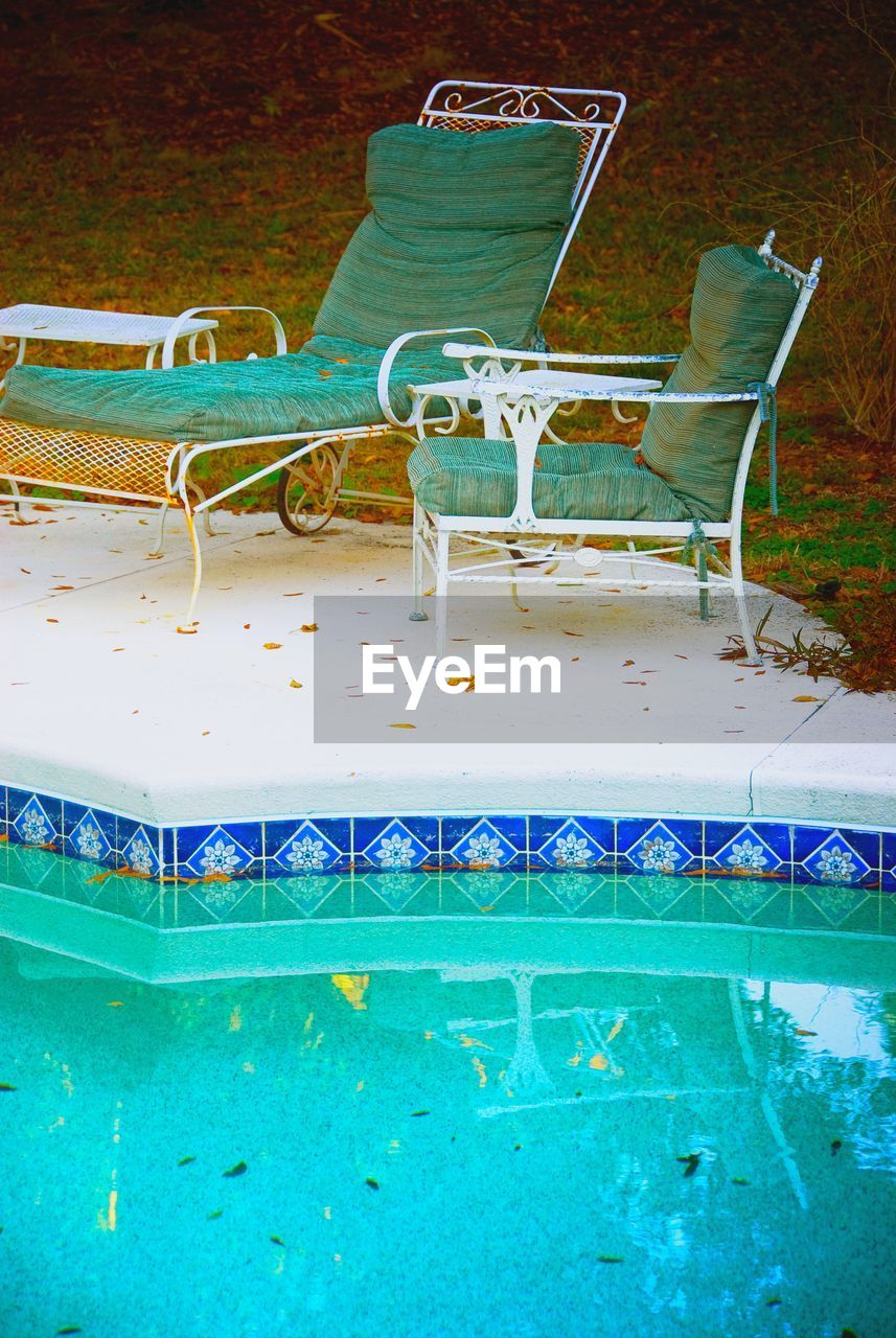 no people, swimming pool, chair, blue, indoors, day, water