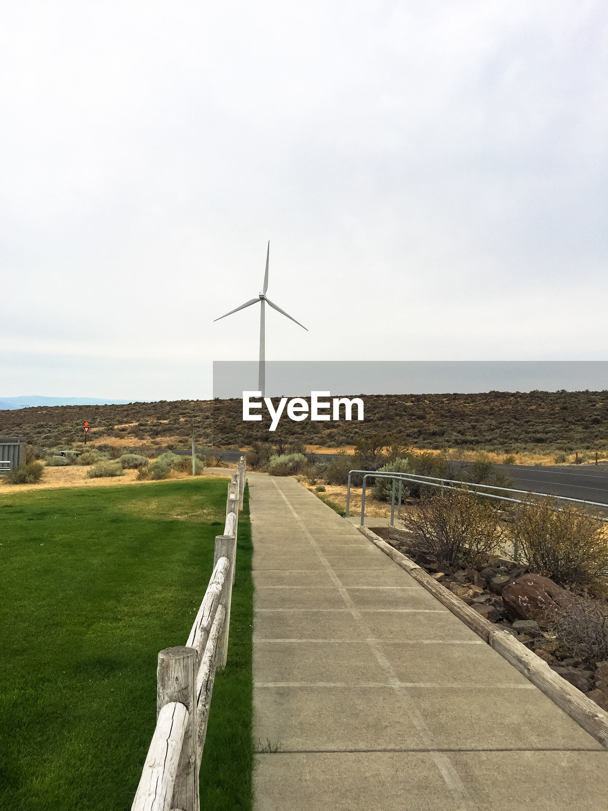 wind turbine, alternative energy, renewable energy, wind power, environmental conservation, fuel and power generation, windmill, industrial windmill, field, day, no people, nature, sky, outdoors, rural scene, grass, landscape, beauty in nature, traditional windmill