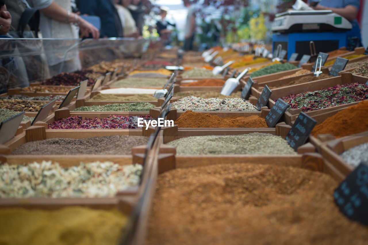 selective focus, in a row, choice, food, variation, market, for sale, retail, indoors, food and drink, incidental people, day, arrangement, freshness, business, large group of objects, market stall, store, close-up, retail display, consumerism, tray