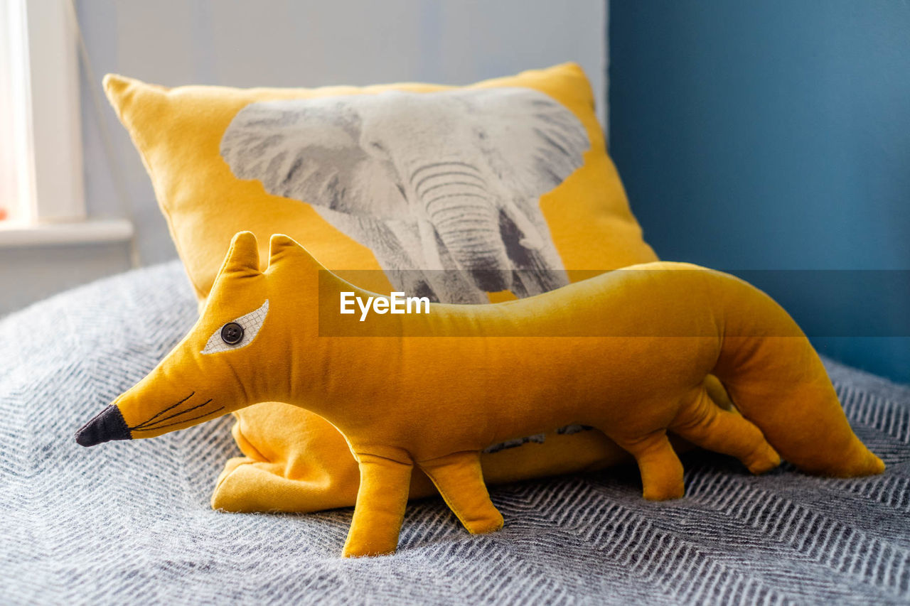 CLOSE-UP OF STUFFED TOY ON BED