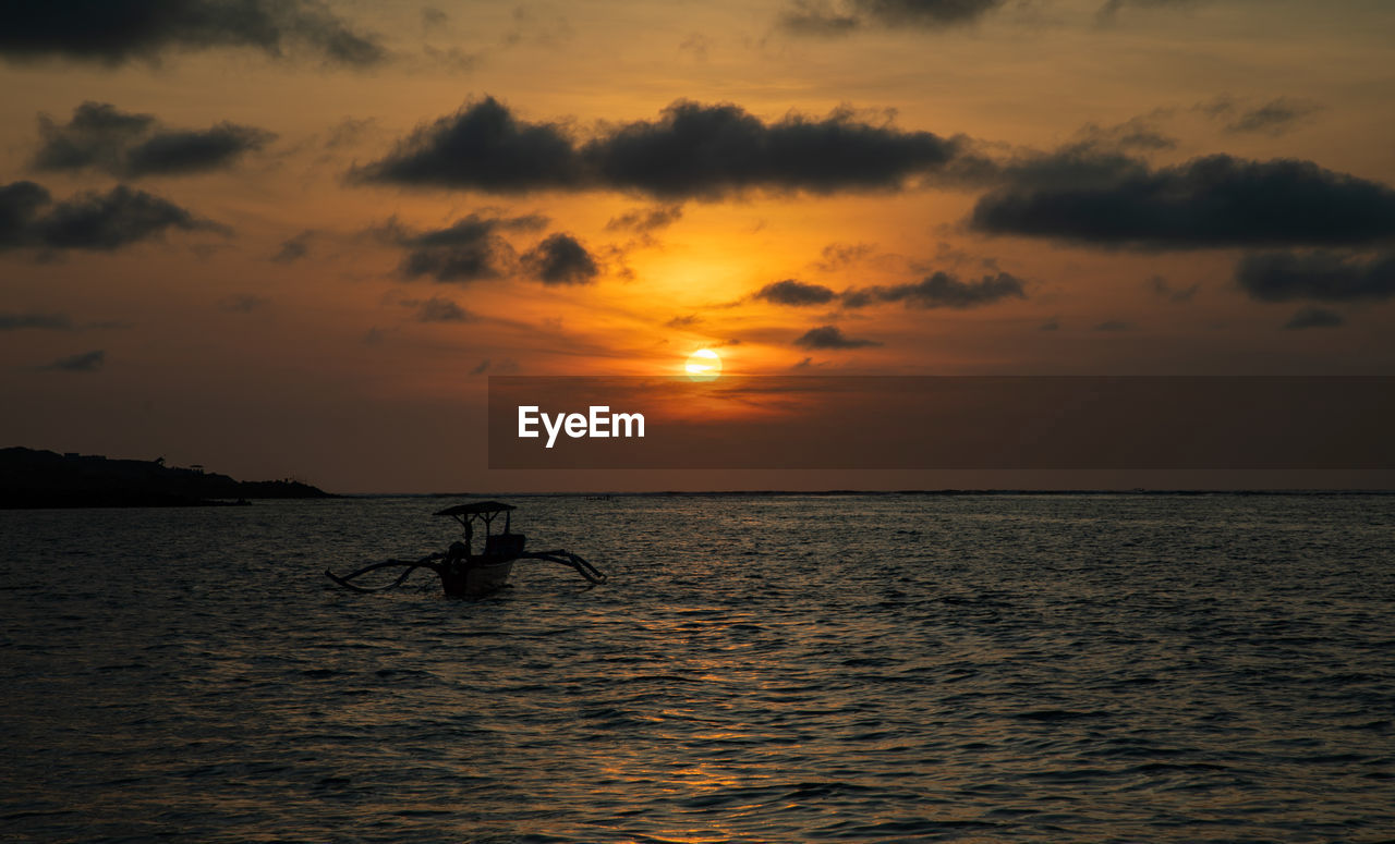 sunset, water, sky, scenics - nature, beauty in nature, silhouette, waterfront, cloud - sky, orange color, sea, horizon, horizon over water, nautical vessel, transportation, real people, tranquil scene, tranquility, idyllic, mode of transportation, outdoors