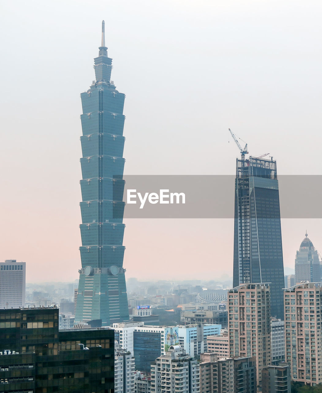 architecture, skyscraper, city, building exterior, tower, built structure, tall - high, modern, cityscape, no people, travel destinations, tall, urban skyline, downtown district, outdoors, sky, day