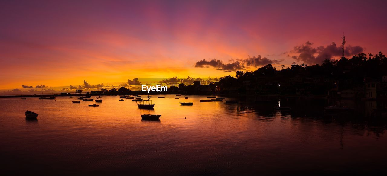 sunset, orange color, water, reflection, sky, silhouette, beauty in nature, scenics, nature, cloud - sky, no people, tranquil scene, nautical vessel, tranquility, outdoors, harbor