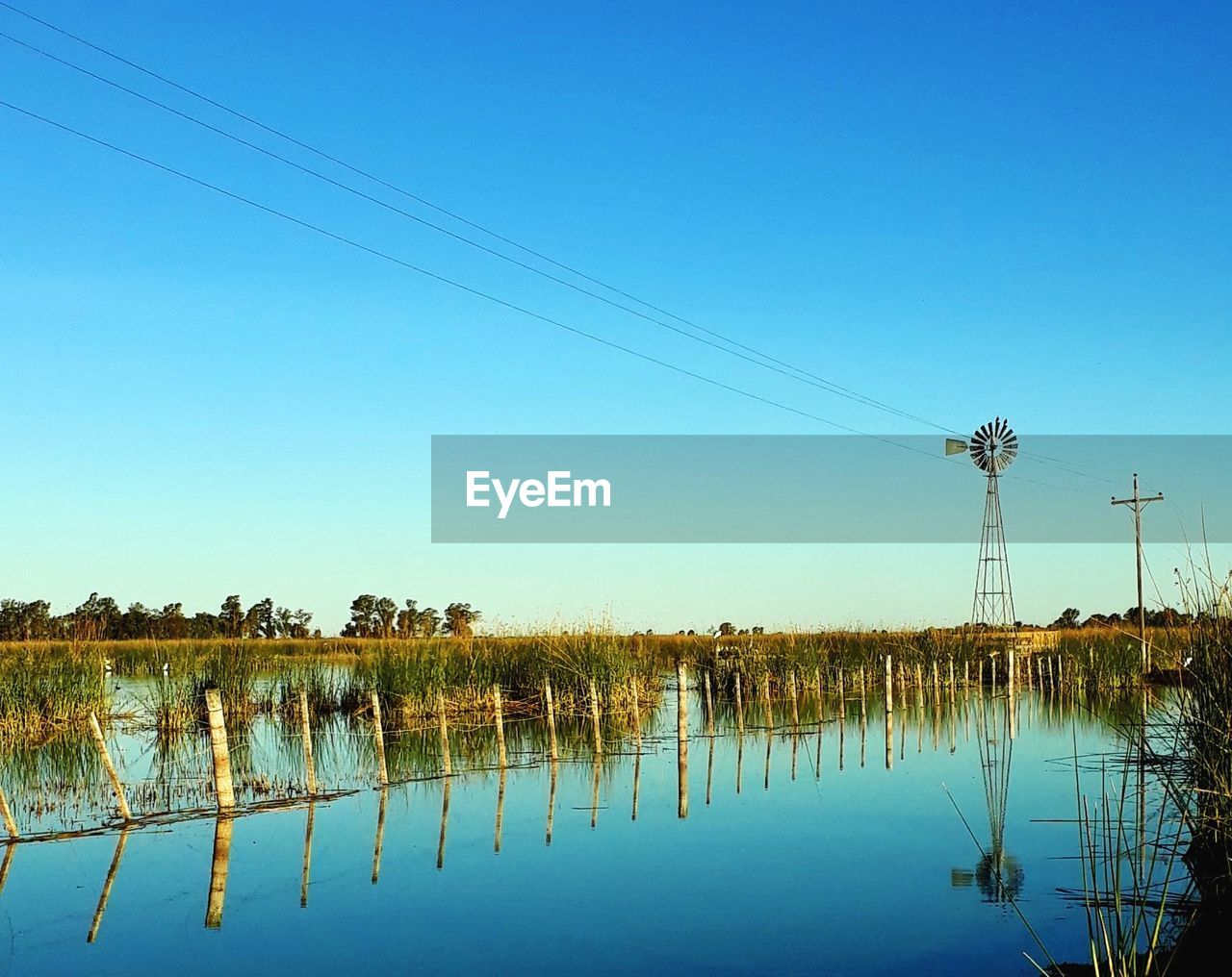 cable, power line, connection, reflection, electricity, power supply, electricity pylon, technology, no people, nature, fuel and power generation, outdoors, water, day, clear sky, lake, sky, tree, beauty in nature, telephone line