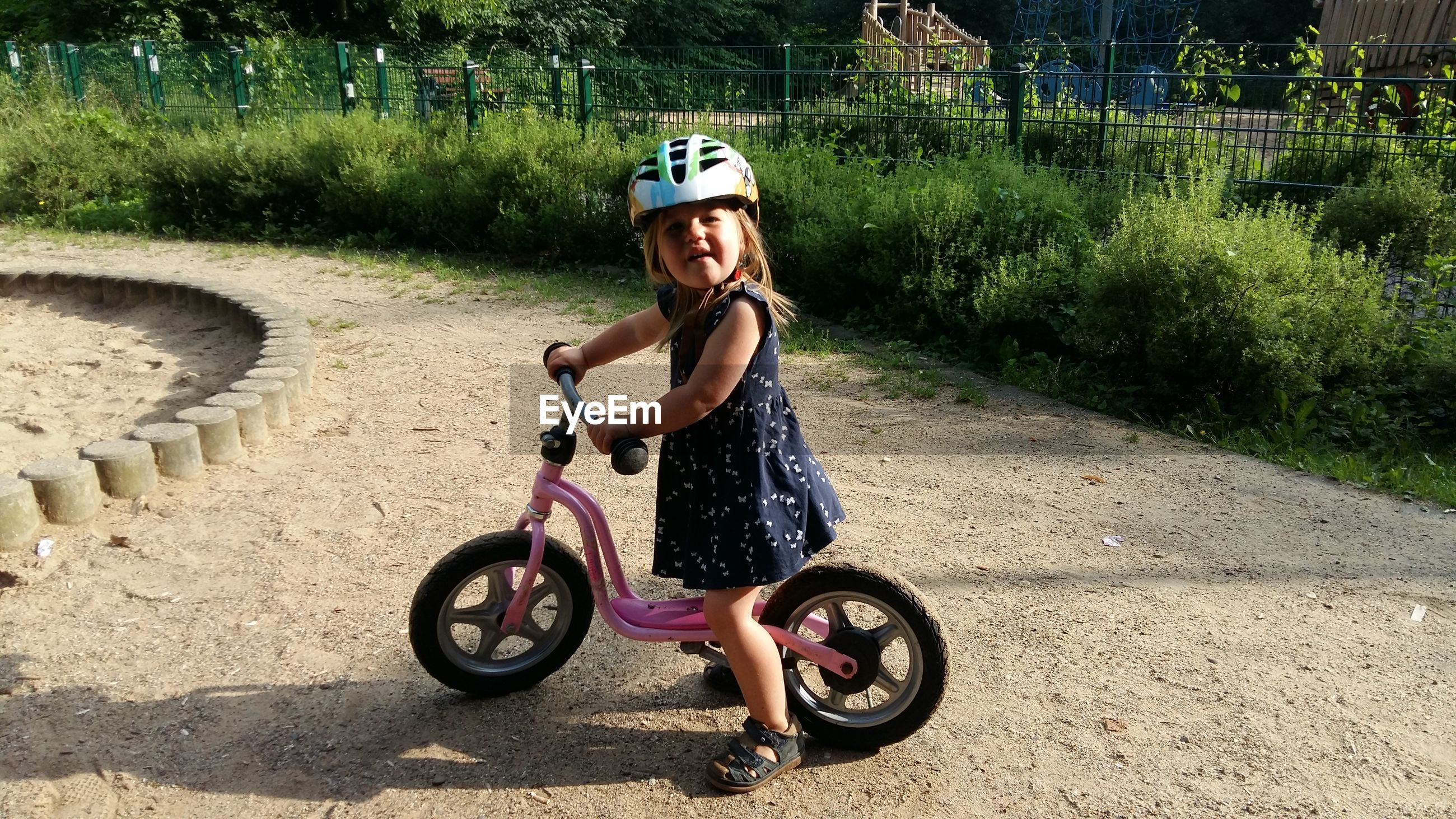 Portrait of girl riding bicycle outdoors