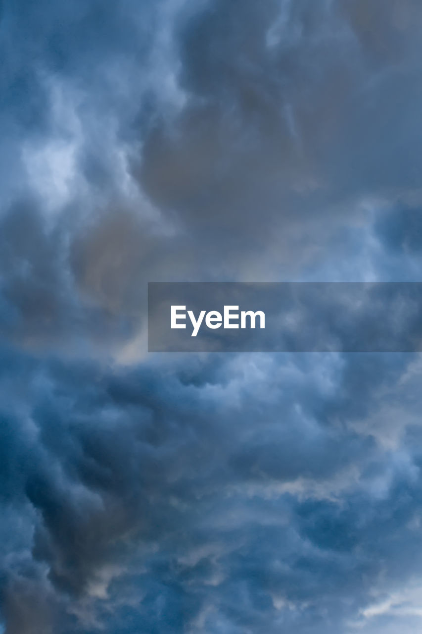 cloud - sky, sky, beauty in nature, scenics - nature, low angle view, storm, no people, backgrounds, overcast, tranquility, cloudscape, nature, full frame, dramatic sky, storm cloud, tranquil scene, outdoors, idyllic, blue, ominous, meteorology
