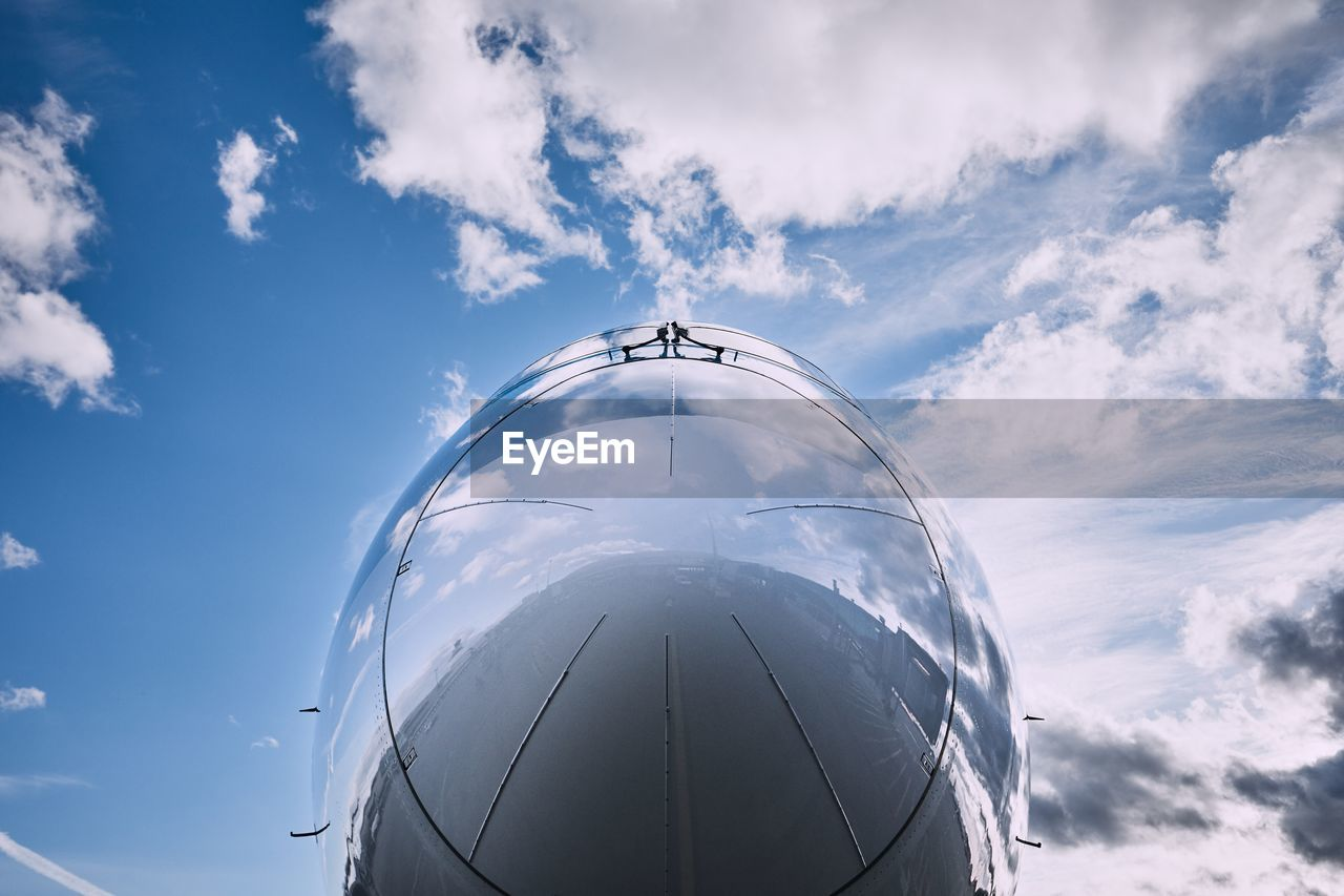sky, cloud - sky, air vehicle, airplane, transportation, mode of transportation, nature, day, low angle view, outdoors, travel, no people, flying, glass - material, blue, mid-air, public transportation, motion, on the move, close-up, aerospace industry, plane