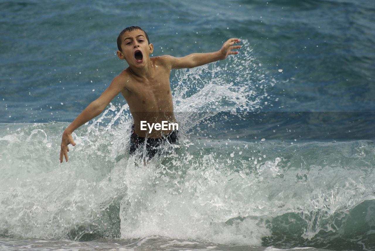 Portrait Of Boy Enjoying At Beach