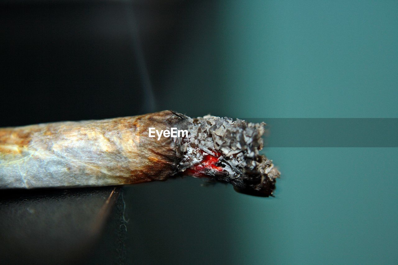 Close-Up Side View Of A Cigarette