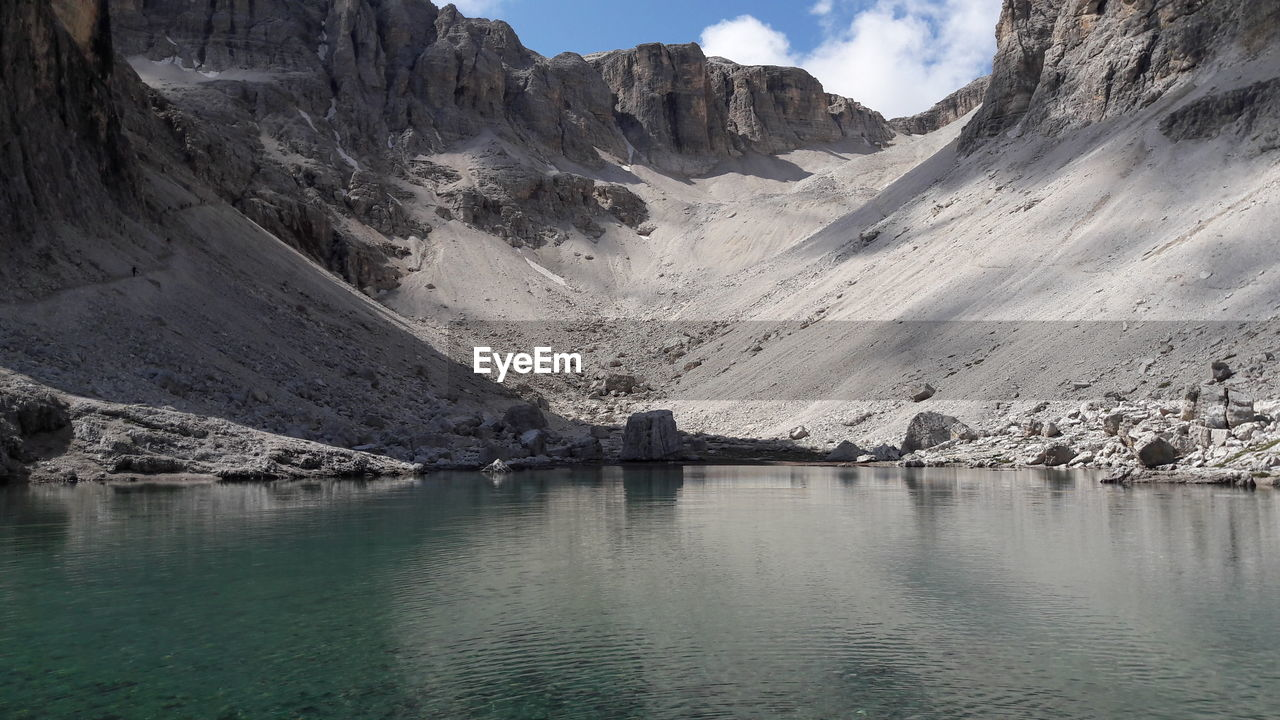 mountain, water, scenics - nature, beauty in nature, tranquil scene, tranquility, mountain range, waterfront, lake, nature, non-urban scene, no people, day, environment, sky, cold temperature, landscape, cloud - sky, outdoors, formation, snowcapped mountain
