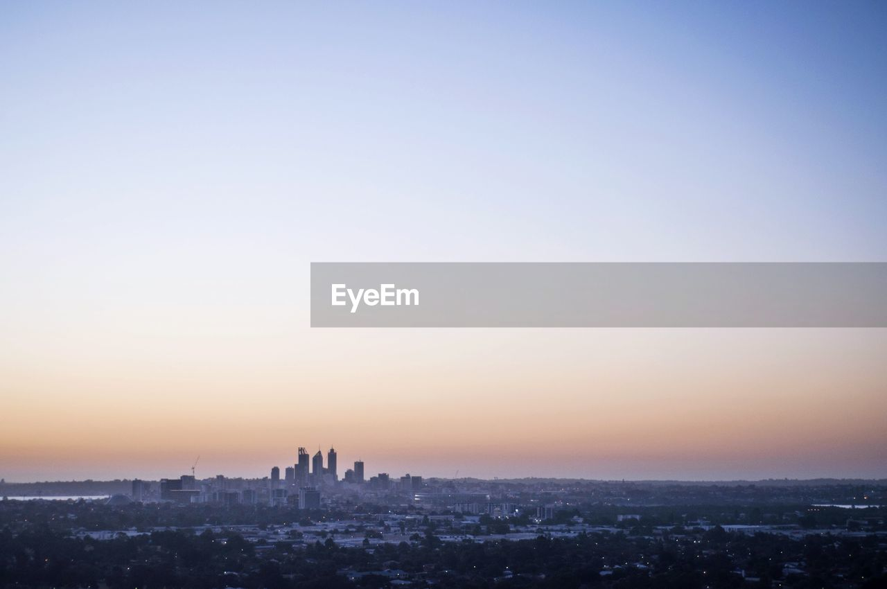 architecture, cityscape, building exterior, city, built structure, sunset, travel destinations, skyscraper, modern, outdoors, no people, growth, clear sky, urban skyline, sky, nature, day