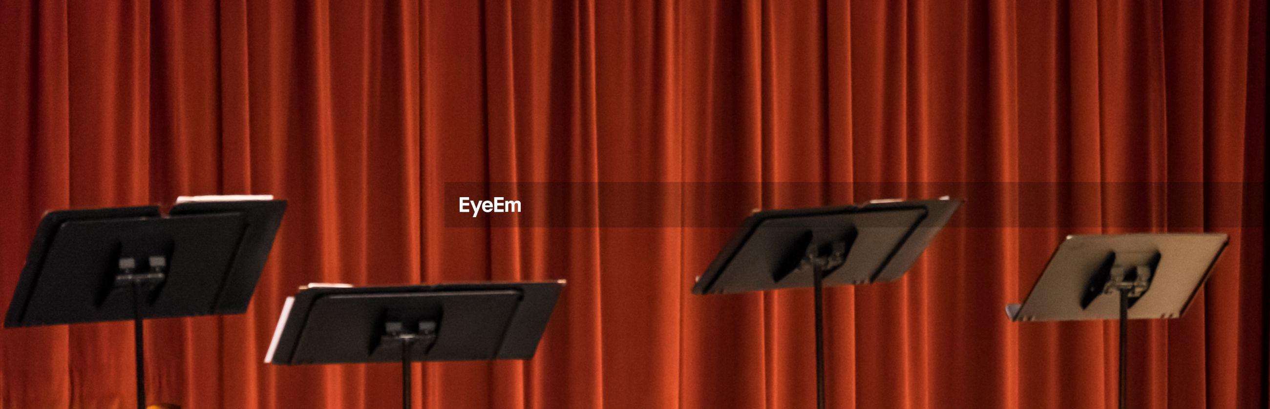 curtain, stage - performance space, red, communication, performing arts event, movie theater, indoors, arts culture and entertainment, no people, film industry, close-up, day