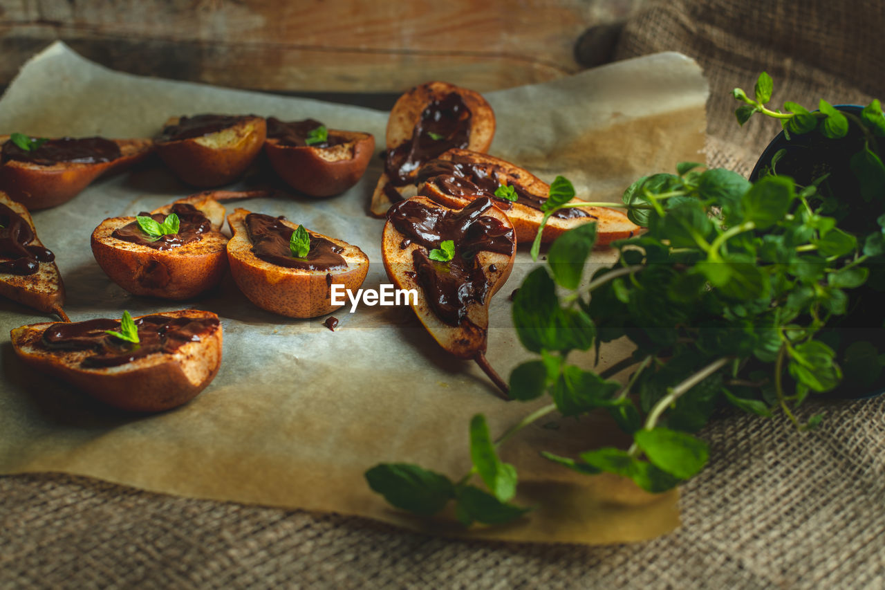 food and drink, food, freshness, table, still life, ready-to-eat, no people, indoors, wellbeing, healthy eating, close-up, high angle view, bread, vegetable, leaf, selective focus, plant part, plate, serving size, wood - material, herb, snack, tray