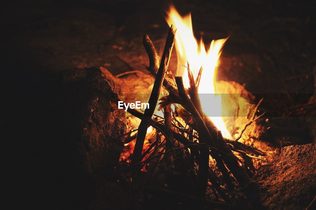 heat - temperature, flame, burning, fire, nature, fire - natural phenomenon, night, glowing, no people, log, firewood, wood, wood - material, close-up, orange color, outdoors, bonfire, dark, land, environment, campfire